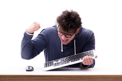 The funny nerd man working on computer isolated on white. Funny nerd man working on computer isolated on white Royalty Free Stock Photography
