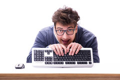 Funny nerd man working on computer  on white. Funny nerd man working on computer Royalty Free Stock Image