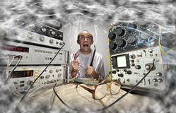 Funny nerd scientist. Soldering at vintage technological laboratory Royalty Free Stock Photo