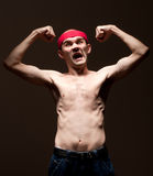 Funny nerd showing his biceps Stock Photo