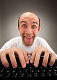 Funny nerd working on computer Royalty Free Stock Images