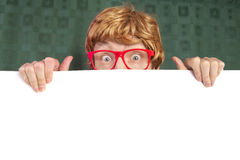Funny nerdy guy. Funny guy with a blank card Royalty Free Stock Images