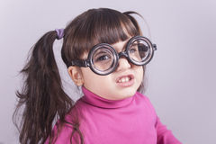 Funny nerdy little girl royalty free stock images