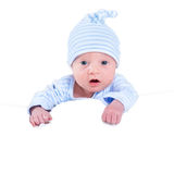 Funny newborn baby boy playing on his tummy Royalty Free Stock Photo