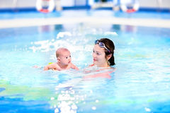 Funny newborn baby boy swimming with his mother Royalty Free Stock Images
