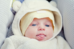 Funny newborn baby in the car seat Royalty Free Stock Photo