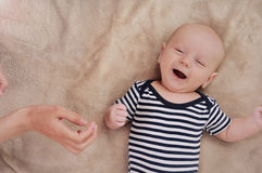 Funny newborn boy singing song. Under care mother; singing cute newborn baby; maternity concept; soft image of beautiful family royalty free stock photography