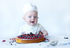 Funny newborn confectioner. Royalty Free Stock Photos