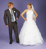 Funny Newlyweds standing on blue Stock Photography