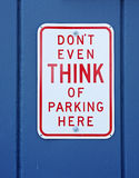 Funny no parking sign. Mounted on the wall of small business royalty free stock images