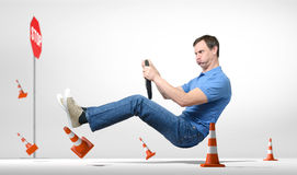 Funny novice man car driver with a wheel royalty free stock image