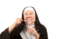 Funny Nun Blowing Bubbles Stock Photo