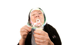 Funny nun with blowing bubbles Royalty Free Stock Images