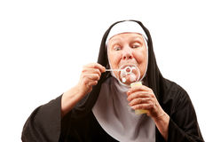 Funny nun with blowing bubbles Stock Photography