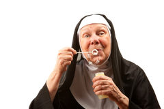 Funny Nun Blowing Bubbles Stock Images