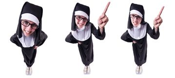 The funny nun isolated on the white background. Funny nun isolated on the white background stock photography