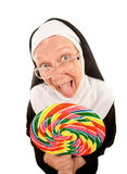 Funny Nun with Lollipop. Funny Nun in Religious Habit Licking Lollipop Stock Photography