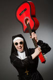 The funny nun with red guitar playing Royalty Free Stock Photo