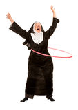 Funny Nun in Socks with Toy Hoop Royalty Free Stock Photography