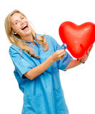 Funny nurse woman listening heart isolated on white background. Funny nurse woman listening Red heart balloon Royalty Free Stock Images