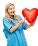Funny nurse woman listening heart isolated on white background Stock Photo