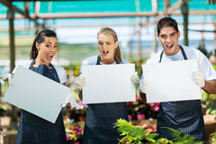 Funny nursery workers stock photo
