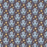 Funny octopus. Seamless vector illustration with cartoon octopuses and stars Royalty Free Stock Photo