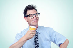 Funny office man drinking from a paper cup with a straw. Eyes closed of pleasure Royalty Free Stock Photography