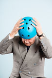 Funny man wearing cycling helmet portrait real people high defin Stock Photos