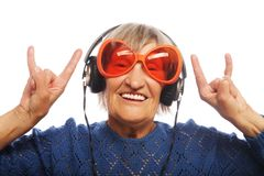 Funny old lady listening music Royalty Free Stock Photography