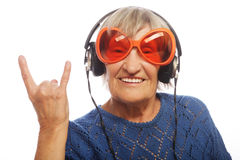 Funny old lady listening music Stock Photos