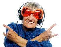 Funny old lady listening music and showing thumbs up. Royalty Free Stock Images
