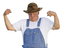 Funny Old Man Flexing Muscles. Are you as tough as this old guy? An older man with overalls on flexing his muscles showing his macho strength. CLIPPING PATH Royalty Free Stock Image