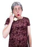 Funny Old Mature Senior Woman Talk Gossip Phone. A funny and ugly old mature senior talks on the phone. Granny has shock and surprise on her face while the royalty free stock photography