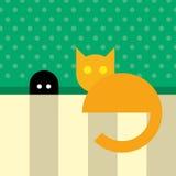 Funny orange cat sitting near mouse hole Stock Images