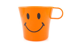 Funny orange drinking cup. With smile isolated on white background Stock Photography