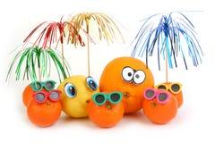 Funny orange, lemon and mandarins Royalty Free Stock Images