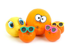 Funny orange, lemon and mandarins Stock Photos