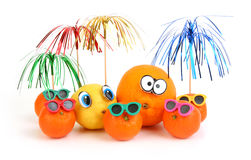 Funny orange, lemon and mandarins Royalty Free Stock Photo