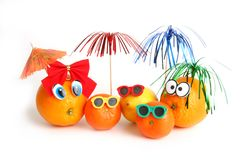 Funny oranges, lemon and mandarins Royalty Free Stock Images