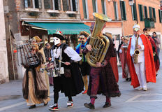 Funny orchestra. Venice,Italy-Ferburary 26th, 2011: Funny orchestra marching and singing in the streets of Venice during The Carnival days.The Carnival of Venice Royalty Free Stock Photography