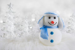 Funny original snowman on abstract winter ice trees background Royalty Free Stock Image