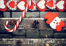 Funny outdoor Christmas composition with pine cones, lollipop royalty free stock photography