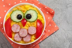 Funny owl mashed potato vegetable puree with sausage for kids lunch Stock Photography