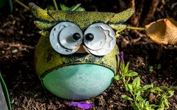 Funny owl model statue in a garden close up decoration outdoor stock photos
