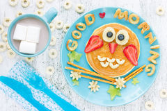 Funny owl pancakes for kids breakfast. Funny owl pancakes with peanut butter and fruits for kids breakfast royalty free stock photo