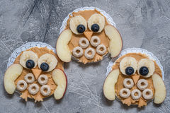 Funny owl with peanut butter and fruits on rice cake Stock Photo