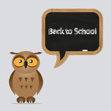 Funny owl with school board Stock Image