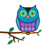 Funny owl sitting on a tree branch Stock Photos