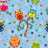 Funny owls and tree seamless pattern over blue Royalty Free Stock Photo